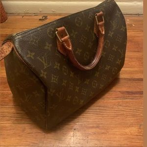 Well-maintained Vintage Louis Vuitton Speedy Bag.